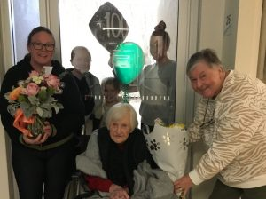 Kathleen with family for 100th birthday